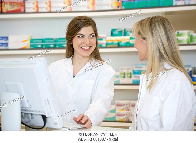 Two female pharmacists communicating