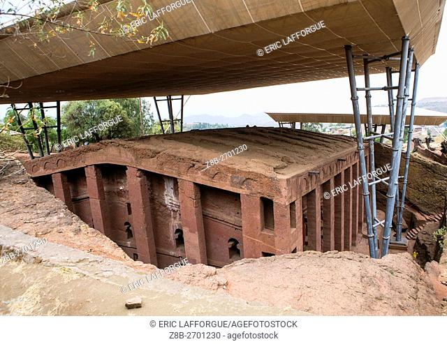 Ethiopia, Amhara Region, Lalibela, protective shelters over a monolithic rock-cut church