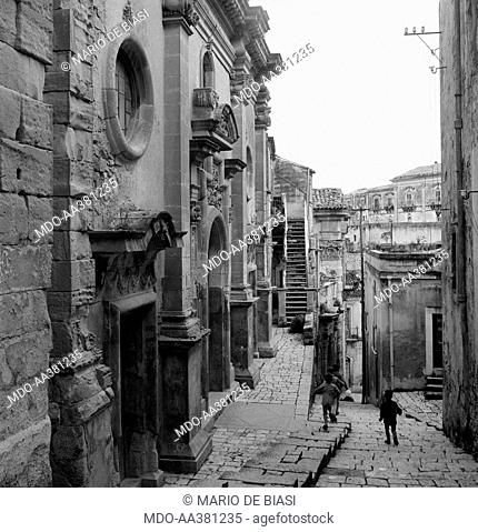 The neighbourhood called Ragusa Ibla. Some children playing in the streets of the neighbourhood called Ragusa Ibla. Ragusa, 1955