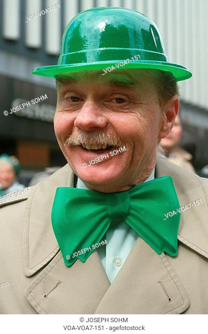 A man dressed in green derby and bow-tie for the St. Patrick's Day Parade, NY City