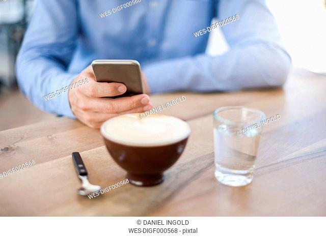 Hand of man holding smartphone, close-up