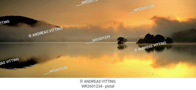 Little islands at sunrise and morning mist, Edersee, Edersee Dam, Hesse, Germany