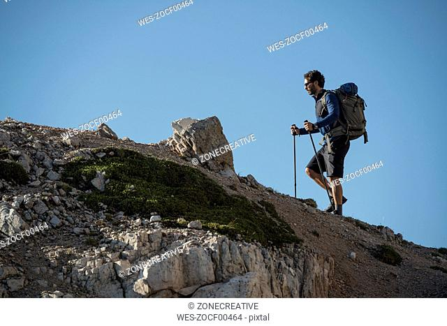 Italy, Man trekking in the Dolomtes