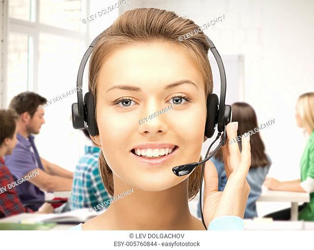 friendly female helpline operator with headphones in office