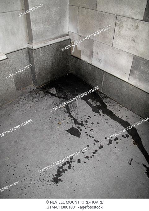 Urine in corner of building at night - splash marks