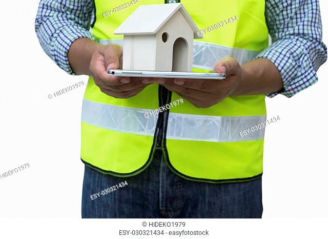 Construction specialist using a tablet computer on white background