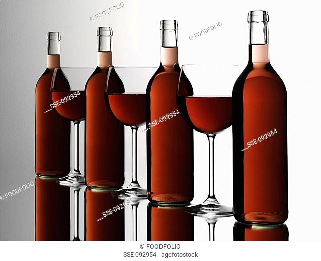 bottles and glasses of rosé wine