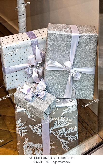 Wrapped Gift Packages Stacked in the Display Window of a New York City Retail Store, signifying Christmas Gifts that one should purchase in that store