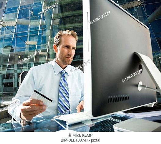 Caucasian businessman shopping online