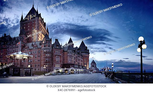 Panorama of Fairmont Chateau Frontenac castle grand hotel with dramatic deep blue sky at night, National Historic Site of Canada