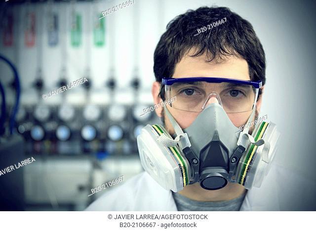 Researcher with protective gas mask. Membranes Laboratory. Tecnalia Research and Innovation. Donostia. San Sebastian. Gipuzkoa. Basque Country. Spain