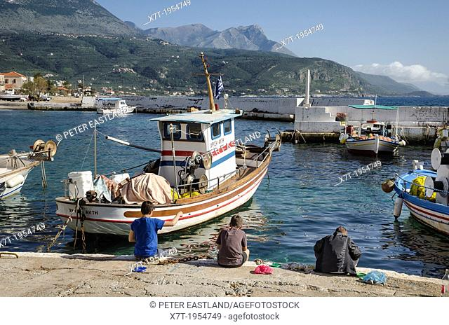 Children fishing in the harbour in the little fishing village of Ayios Nikolaos, in The Outer Mani, Southern Peloponnese, Greece