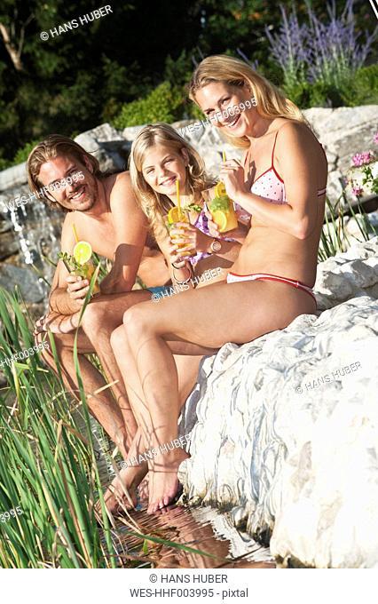 Austria, Salzburg County, Family sitting near pool