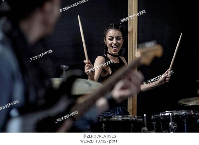 Female rock drummer at recording studio