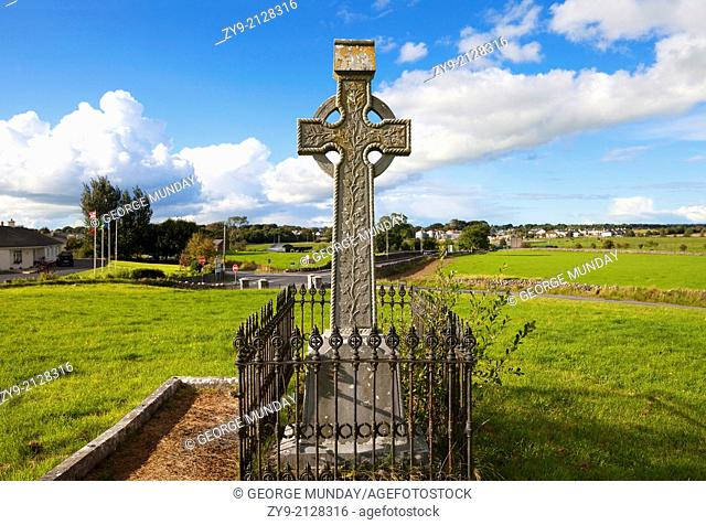 Celtic Cross overlooking the green fields,