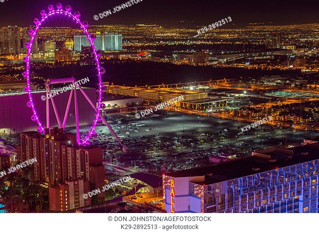 High Roller ferris wheel in Las Vegas at night from the Paris Casino resort hotel Eiffel Tower, Las Vegas, Nevada, USA