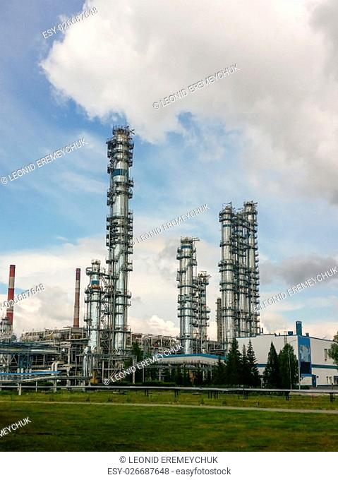 Distillation columns at a petrochemical plant. Deep processing of oil