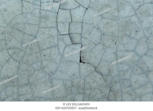 background and texture concept - cracked gray concrete wall