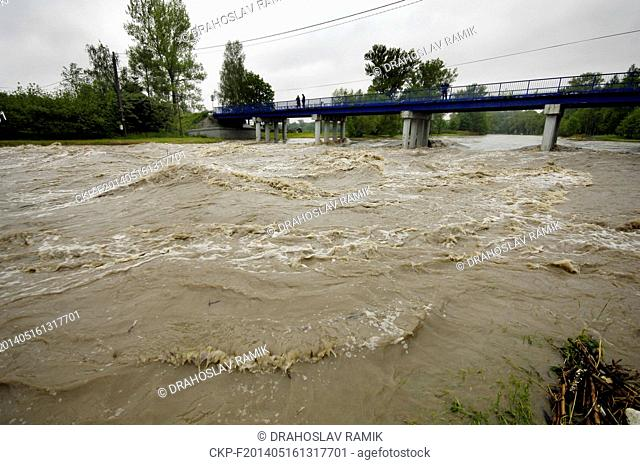 Steady rain raised the water level of the rivers in northern Moravia and Silesia last night and during the day. Pictured river Olse in Vernovice, Czech Republic