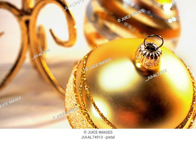 Close-up of a gold Christmas ornament