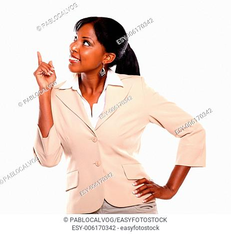 Ethnic businesswoman looking and pointing up on isolated background