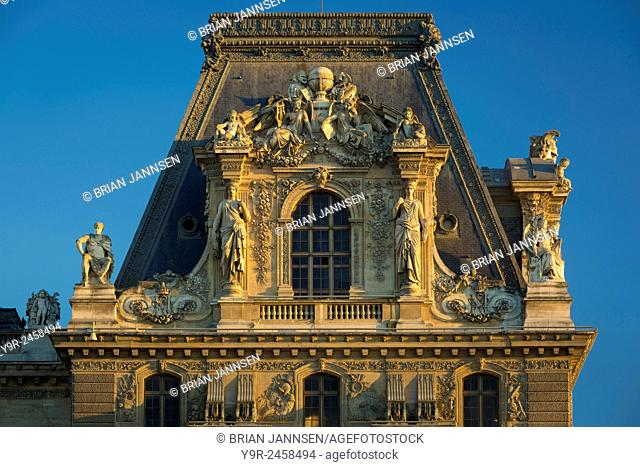 Evening sunlight on architectural details at Musee du Louvre, Paris, France