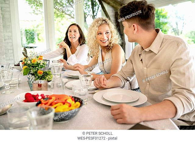 Young man and woman flirting on a family celebration
