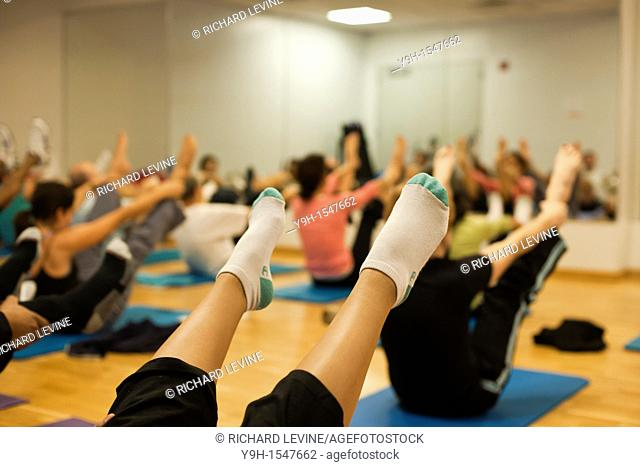 Exercisers participate in a pilates class at the Chelsea Recreation Center in New York