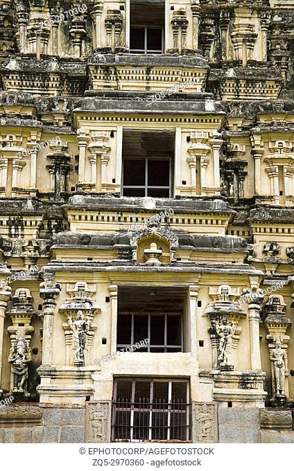 Carving details on the gopuram of Virupaksha Temple, also known as the Pampavathi temple, Hampi, Karnataka, India. The smaller inner gopura and the mandapa were...