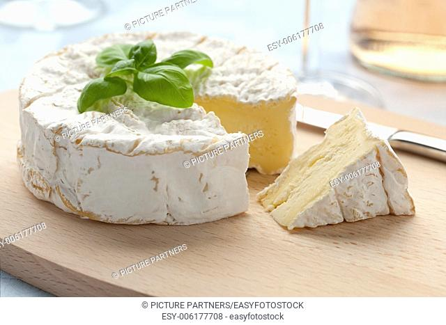 Fresh Camembert cheese and a slice