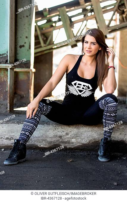 Young woman posing in a sporty outfit, fashion, lifestyle