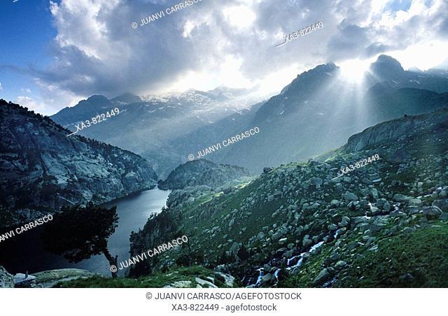 Lights at Black lake and Besiberri mountains, Aigüestortes national park, Catalonia, Spanish pyrenees