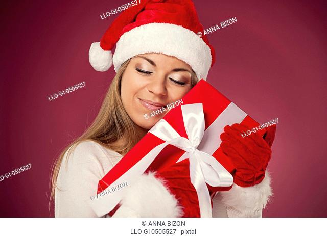 Woman holding a gift, Debica, Poland