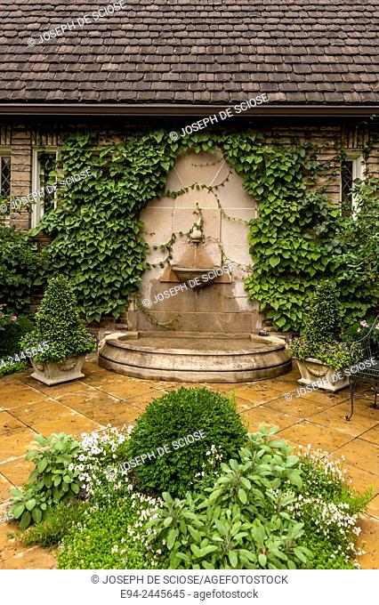 A water feature on a wall in a garden setting. Pittsburgh Pennsylvania USA