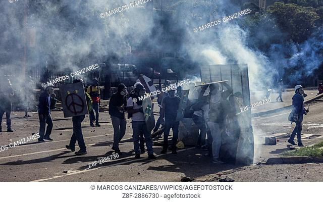 Security forces block anti-government protesters amid tear gas in Caracas, Venezuela, on Wednesday, May 24, 2017. Anti-government protesters clashed with...