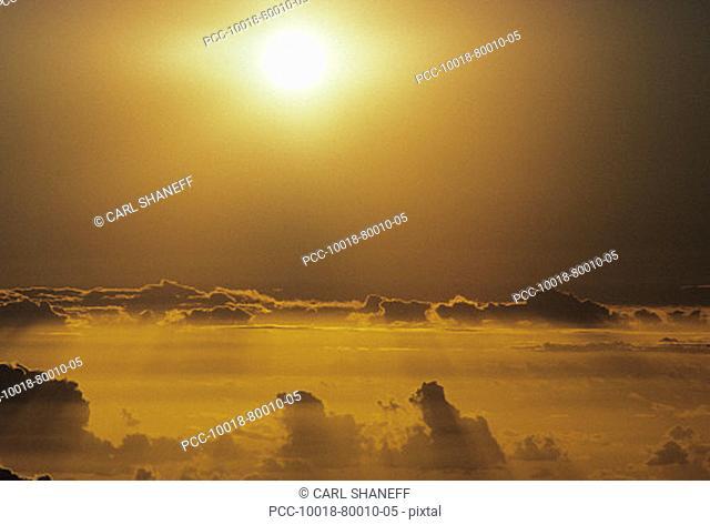 Hawaii, Sunball above clouds in dramatic sunset sky