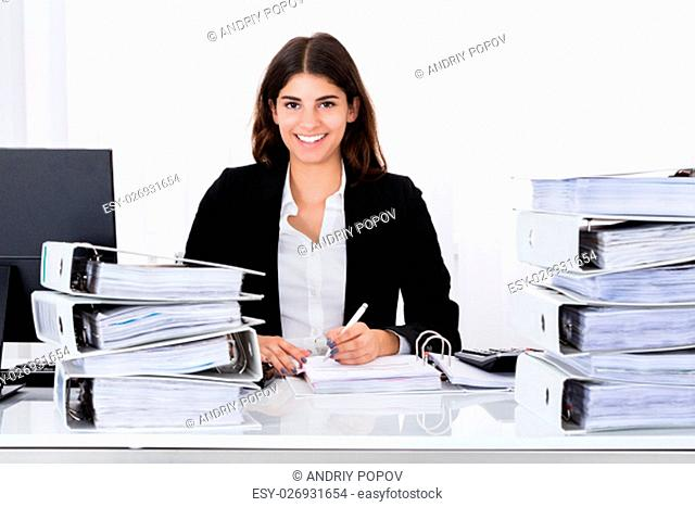 Successful Businesswoman Working On Business Document At Office
