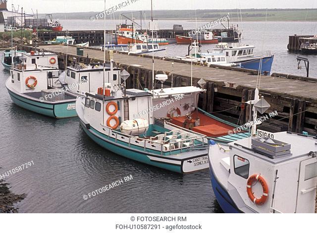 fishing boat, Cape Breton, Cabot Trail, Nova Scotia, NS, Canada, Fishing boats docked in the harbor in the fishing village of Cheticamp on Cape Breton Island on...