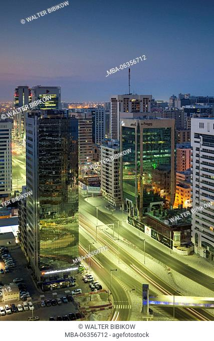 UAE, Abu Dhabi, elevated city skyline from Al Meena Street, dawn