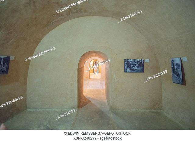 Woman wander through archway of El Badi Palace, ' The Incomparable Palace,' Marrekech, Morocco