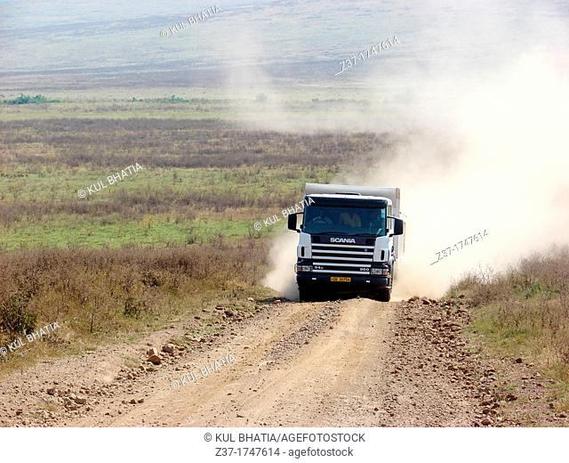 Truck on a dirt road, Serengeti, Tanzania Trucks on such trips bring essential supplies to remote places in Africa and many other countries