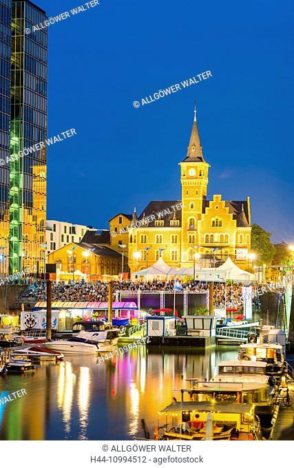 Yacht harbour, Open Air cinema, crane house and former port authority, Rheinauhafen, Cologne, North Rhine-Westphalia, Germany, Europe
