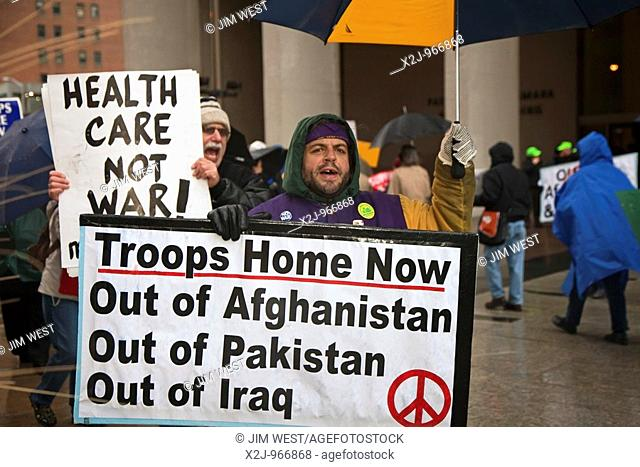Detroit, Michigan - Anti-war activists picket the Federal Building in Detroit to protest President Obama's plan to send 30,000 more troops to Afghanistan