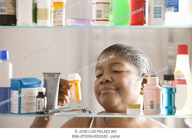 Woman examining pill bottle