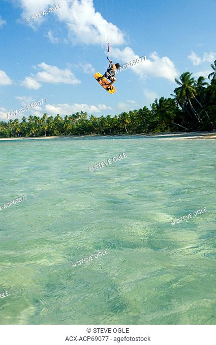 A kiteboarder is inverted on a relatively calm day, Las Terrenas, Dominican Republic
