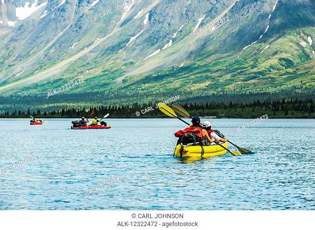 Group kayaking across Twin Lake in Lake Clark National Park and Preserve, Southcentral Alaska, USA
