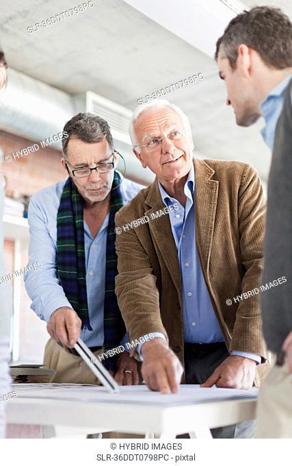 Architects examining blueprints