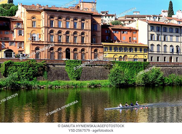 Sport activity on Arno river, residential historic townhouses along Lungarno Torrigiani, Florence, Tuscany, Italy, Europe