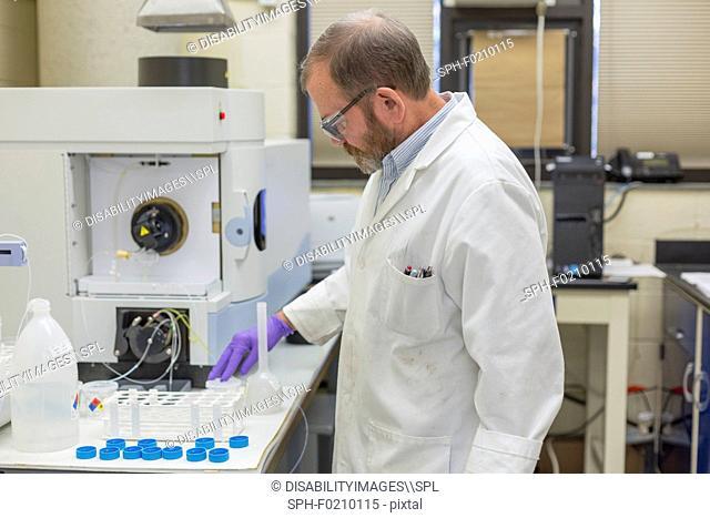Chemist preparing automated water test