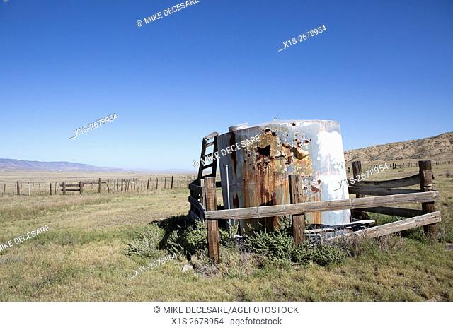 A rusting water tank on ranch land in Central California provides water where little is otherwise available